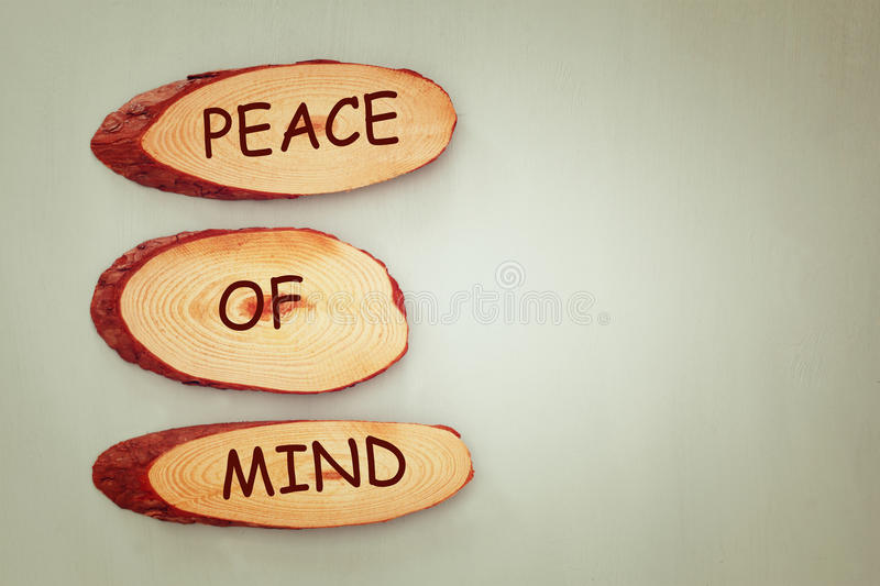 Top view image of wooden signs with the text peace of mind stock photo