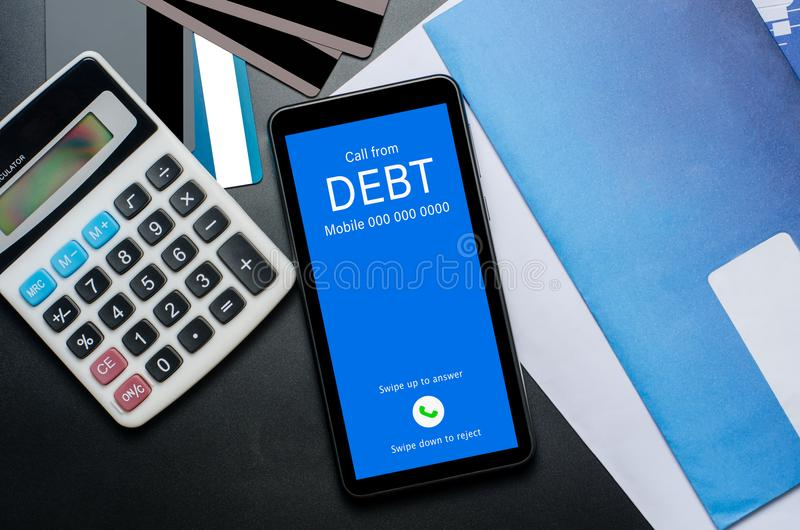 Top view of incoming call on smart phone screen from Creditor. C. Oncept of business financial and debt stock image