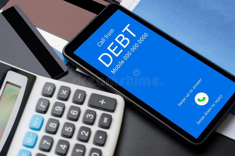 Top view of incoming call on smart phone screen from Creditor. C. Oncept of business financial and debt stock photography