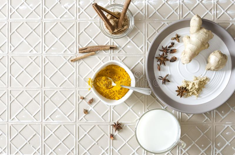 Top view of ingredients for turmeric latte on the stone table.Copy space for your design royalty free stock photo