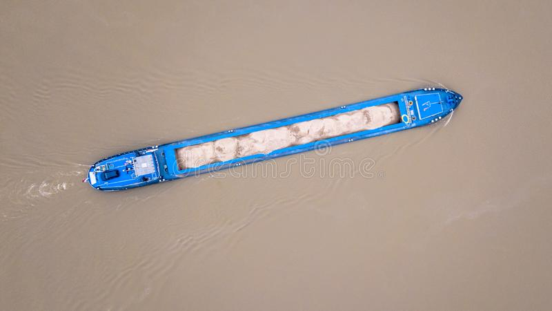 Top view inland freight ship loaded with sand. Top down view on inland freight ship loaded with sand in dutch river Rhine stock photo