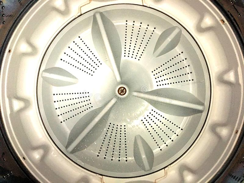 Top view of inside washing machine. Plastic rotate base design. Top view of inside washing machine. Gray plastic rotate base design royalty free stock photography