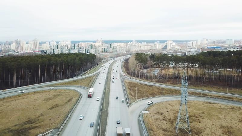 Top view of the interchange of traffic cars outside the city. Video. Traffic cars in the country on the highway.  royalty free stock photography