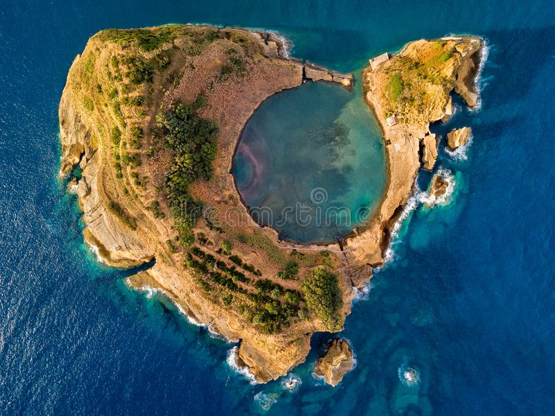 Top view of Islet of Vila Franca do Campo is formed by the crater of an old underwater volcano near San Miguel island, Azores, Por royalty free stock images