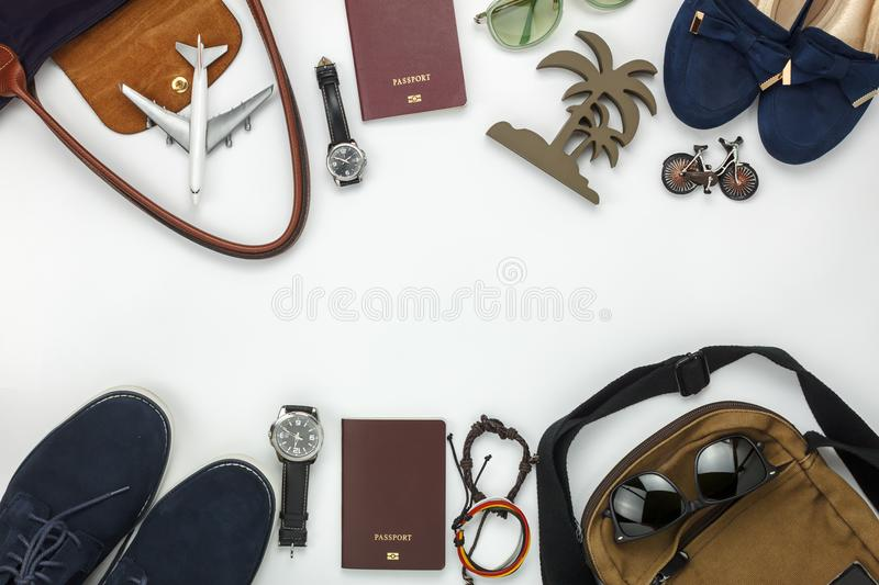 Top view of items for travel with fashion men & women background. Concept.Difference essential accessory on the white wood area.Copy space for creative font or stock photos