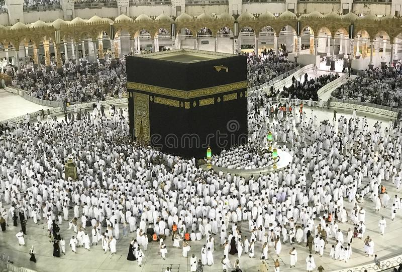 Muslim pilgrims in white cloth in Makkah, Saudi Arabia. Top view of Kaabah and unidentified Muslim pilgrims in white cloth in Makkah, Saudi Arabia stock photography