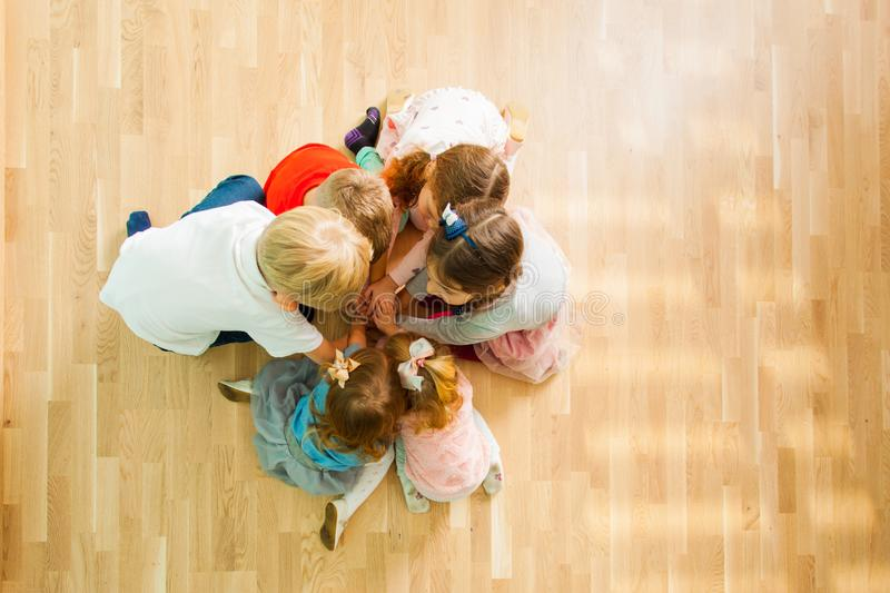 Top view of kids sitting together on a floor stock image