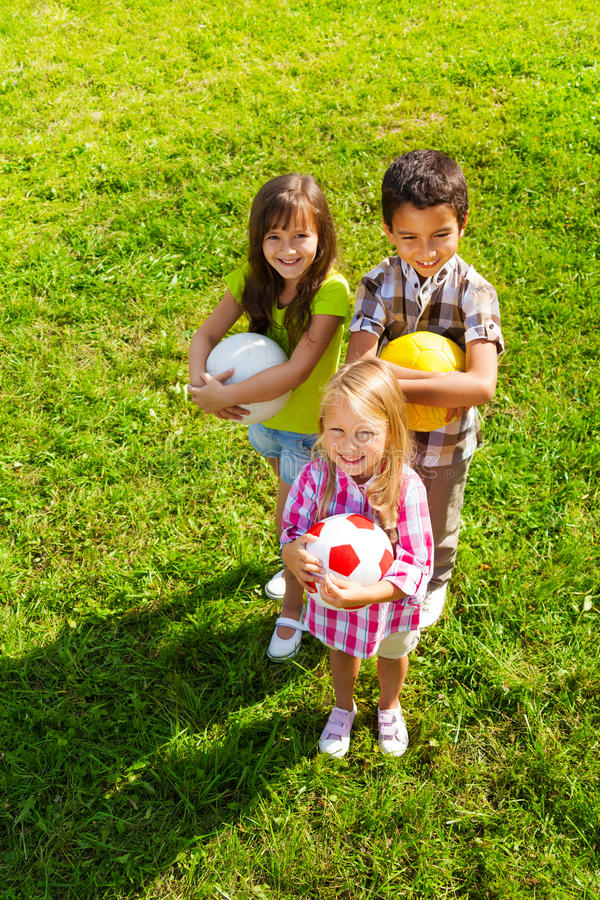 Top view of kids team with sport balls royalty free stock images