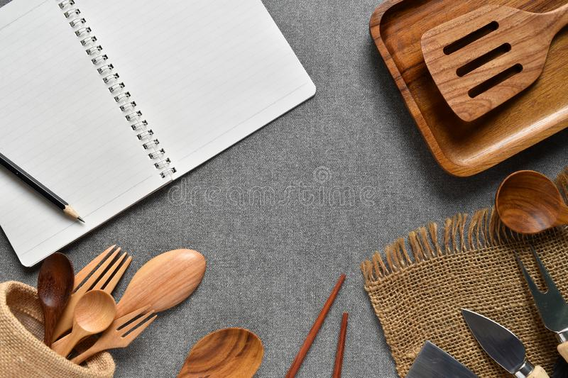 Top view kitchen counter with book and pencil to write recipe food has wooden equipment is elements. stock photo