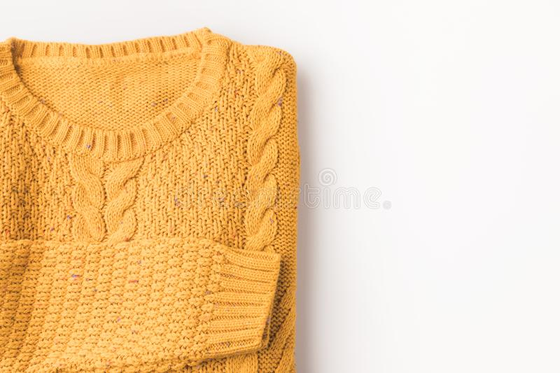 Top view of knitted yellow sweater,. Isolated on white with copy space royalty free stock photos