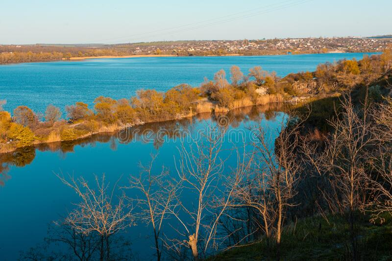 Top view of a lake divided by a road at sunset. Picturesque places royalty free stock images
