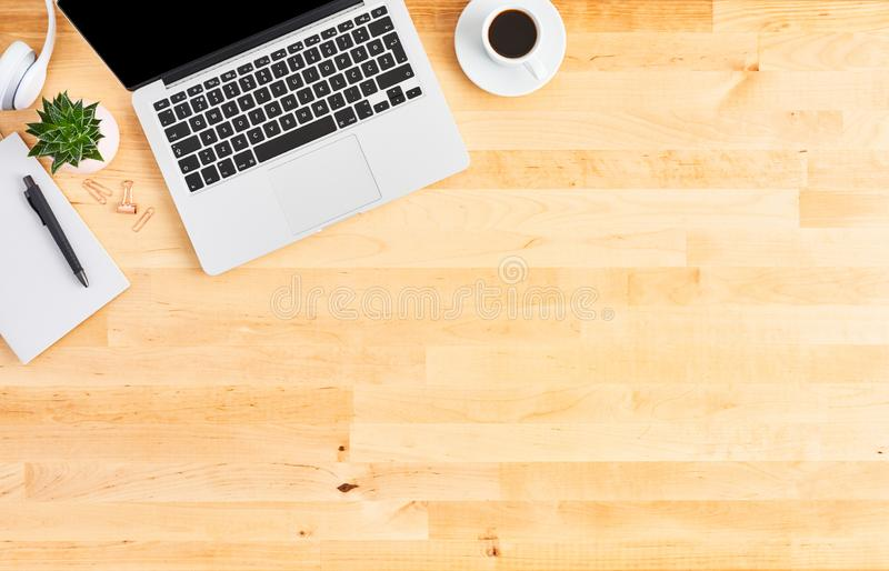 Top view of laptop computer on wooden office desk royalty free stock photo