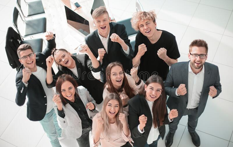 Top view. a large group of young employees showing their success stock photo