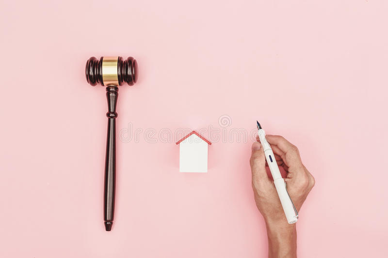 Top view lawyer desk, object on pink background with man hand ho. Lding pen royalty free stock images