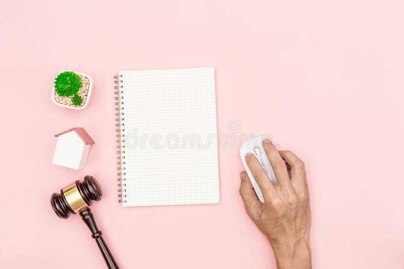 Top view lawyer desk, object on pink background with man hand ho stock photos