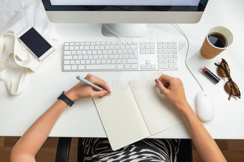 Top view of left handed business woman in minimalistic office. O royalty free stock photo