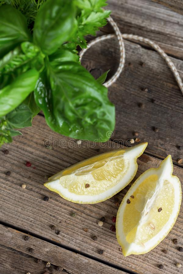 Top view of lemon slices, pepper and herbal bunch stock photo