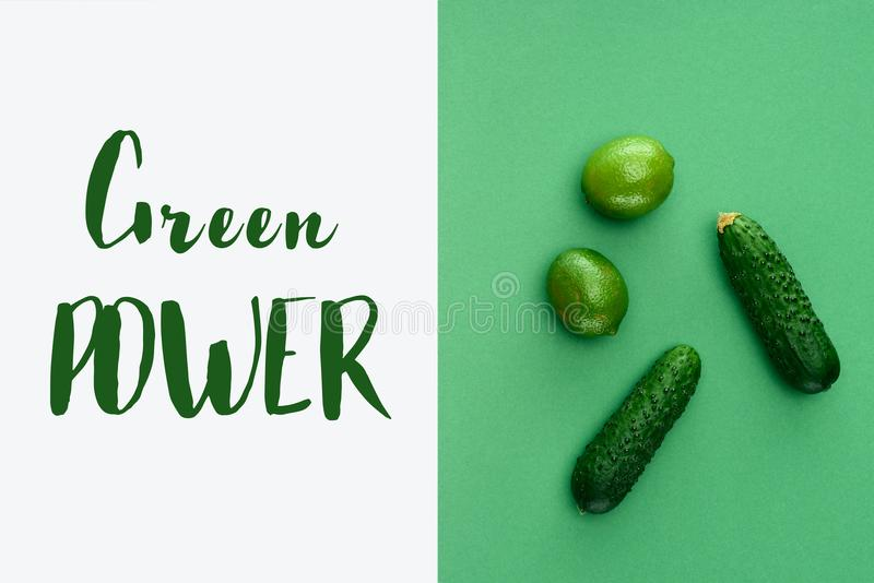 top view of limes and cucumbers with text Green Power on white royalty free stock image