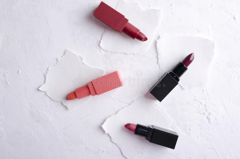 Examples of different colors of lipsticks on the paper royalty free stock photo