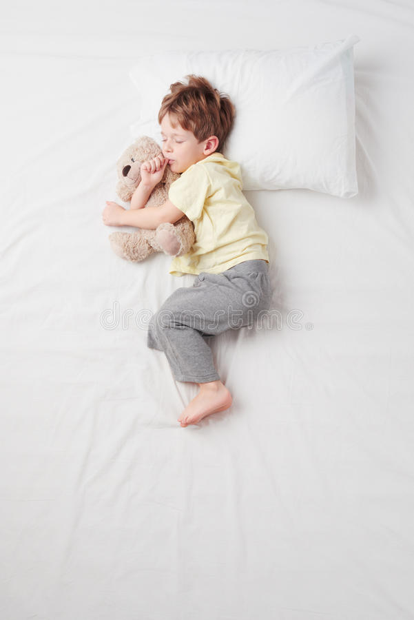 Top view of little boy sleeping in Foetus pose stock images