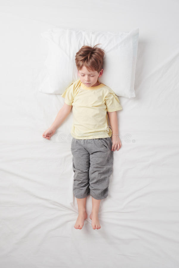 Top view of little boy sleeping in Soldier pose stock photos