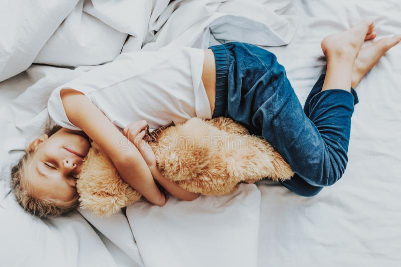 Top view little girl sleeping with teddy bear royalty free stock images