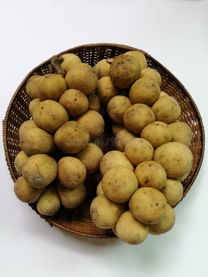 Longkong fruit in basket. Top view of Longkong, southern Thailand fruit, in rattan basket royalty free stock photo