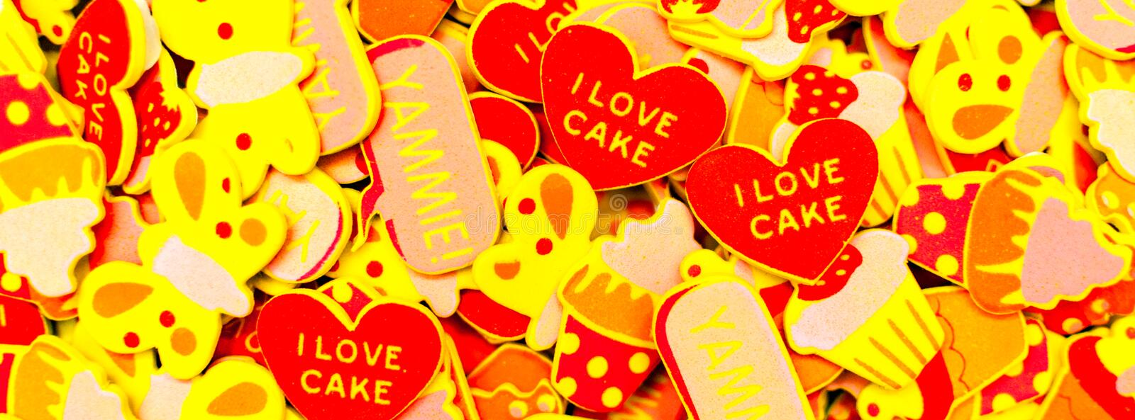Top view of lots of colourful foam stickers depicting hearts, butterflies and cupcakes. Summer or joy concept. Facebook banner. royalty free stock photos