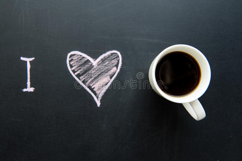Top view of love heart doodle drawing on chalkboard stock images