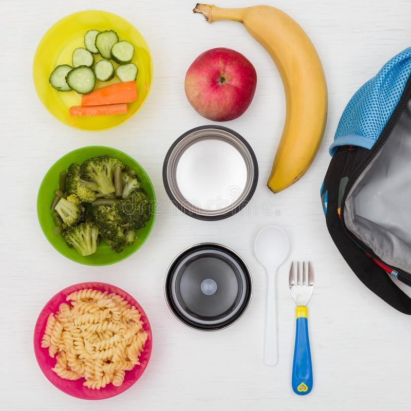 Top view on lunch box, thermos and healthy food options for school. Snacks for the day. Hot lunch, take away. royalty free stock images