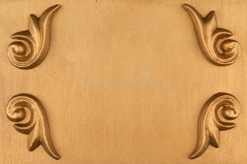 Top view of a luxurious gold stucco on a gold background. stock image
