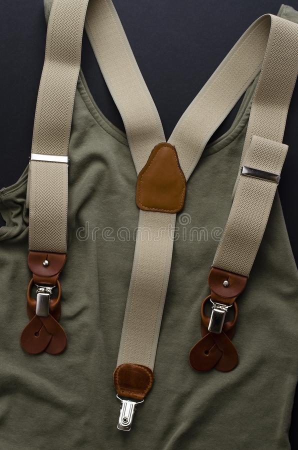Top view of male accessories, suspenders or braces. Vertical image royalty free stock photo