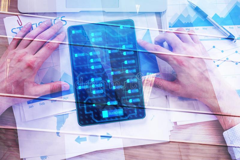 Echnology and accountant concept. Top view of male hands using tabet with digital chart on screen placed on office desk with report and other items. Technology stock photos