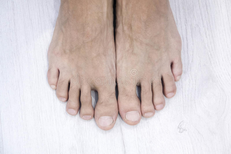 Top view of Male nail and feet on white background,This has a clipping path royalty free stock photo
