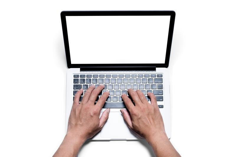 Top view, Male`s hand working by using and typing on white laptop with blank white screen. stock photo