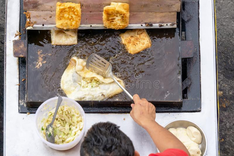 Top view of a man hand cooking martabak jawa royalty free stock images