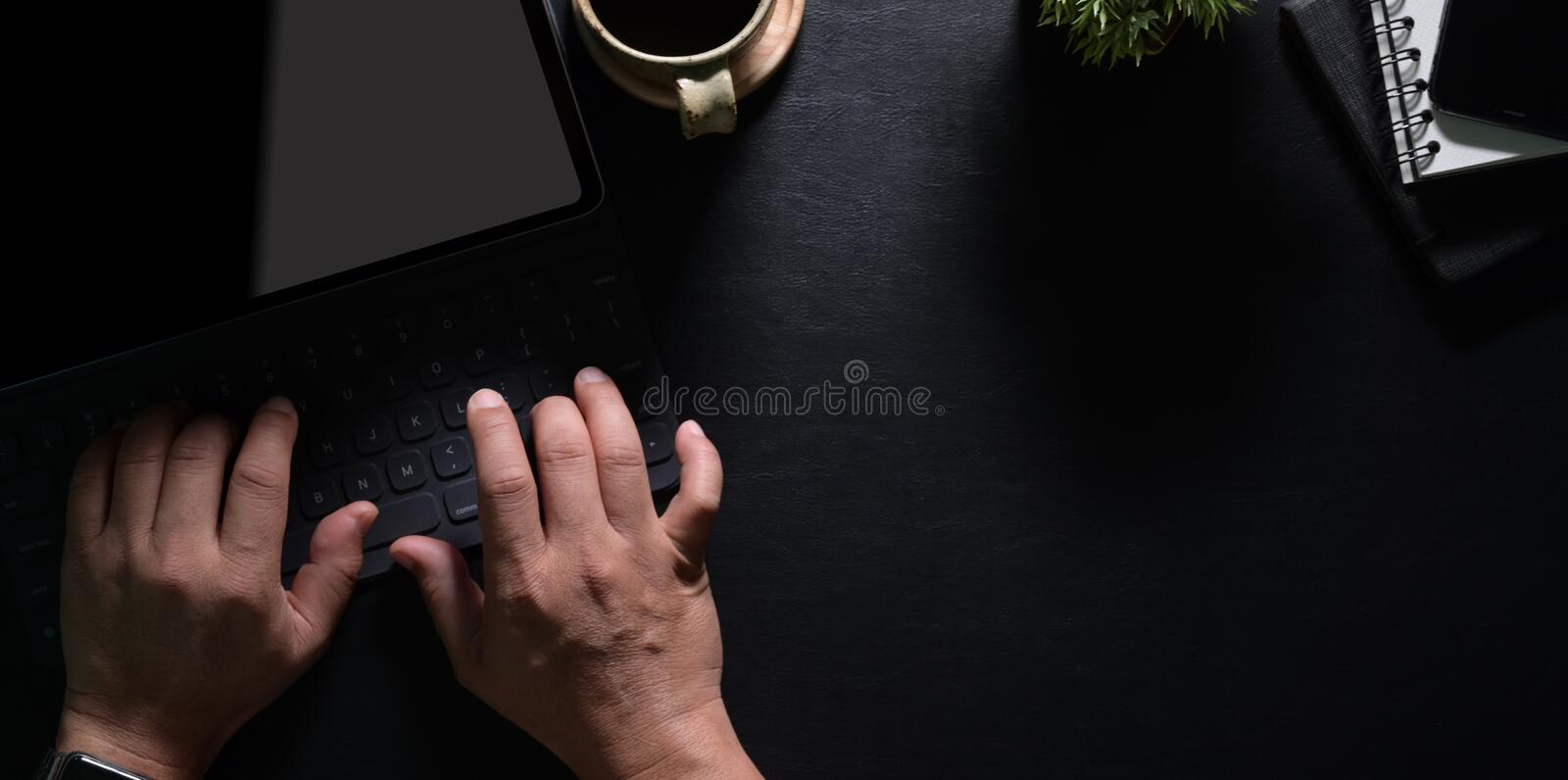 Top view of man`s hands typing on laptop royalty free stock photos