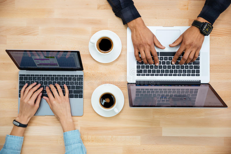 Top view of man and woman working with two laptops stock photo