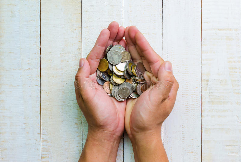 Top view many coins in hands. Investment and business concepts royalty free stock images