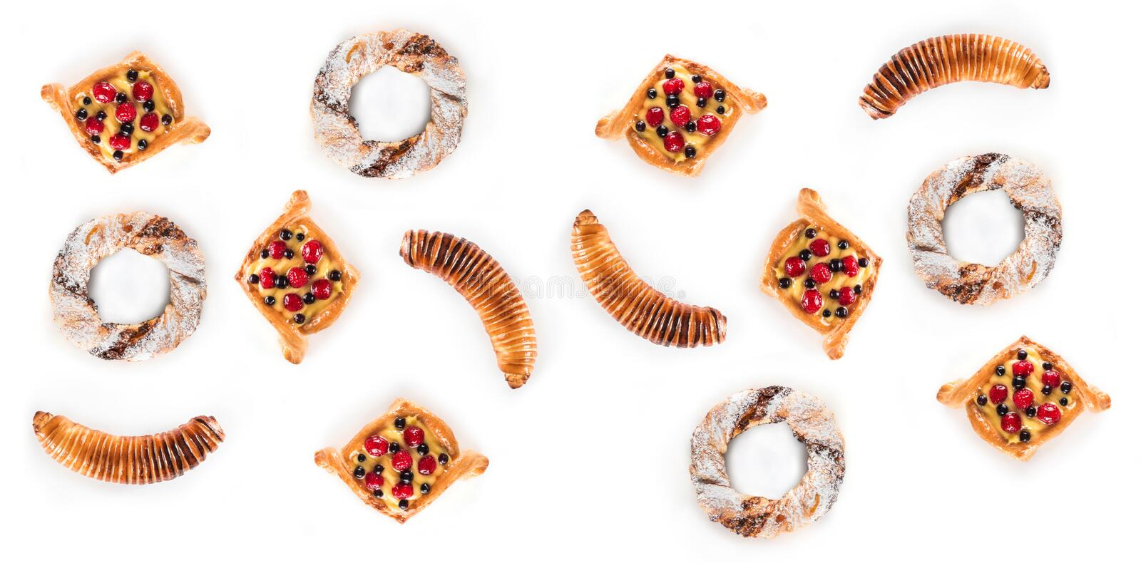 Top view of many delicious pastries isolated on white background royalty free stock photos