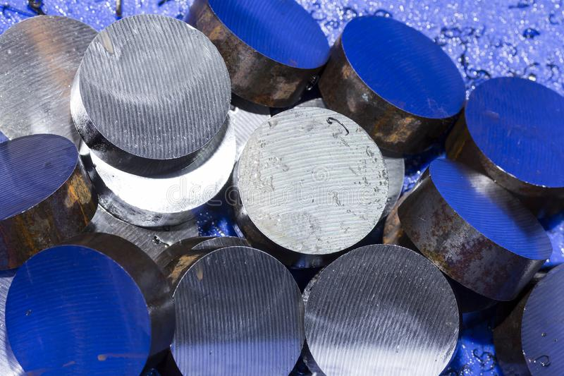 Top view many steel piece round shape after cutting by band saw machine in blue plastic box.  royalty free stock photos