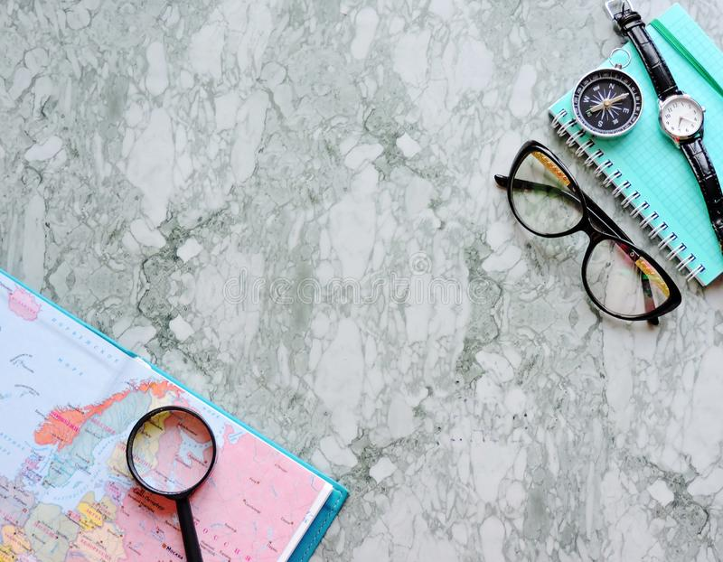 Top View of a map and items. Planning a trip or adventure. Travel planning dreams. Map of the world. Travel, tourism and vacation concept background. Stylish stock image