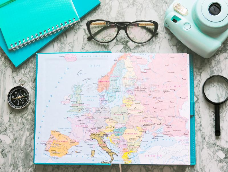 Top View of a map and items. Planning a trip or adventure. Travel planning dreams. Map of the world. Travel, tourism and vacation concept background. Stylish stock photos