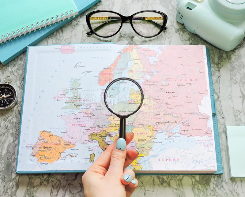 Top View of a map and items. Planning a trip or adventure. Travel planning dreams. Map of the world. Travel, tourism and vacation concept background. Stylish royalty free stock photo