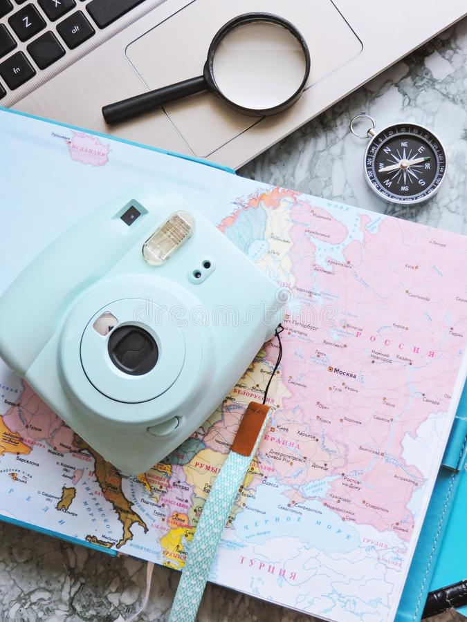 Top View of a map and items. Planning a trip or adventure. Travel planning dreams. Map of the world. Travel, tourism and vacation concept background. Stylish royalty free stock photos