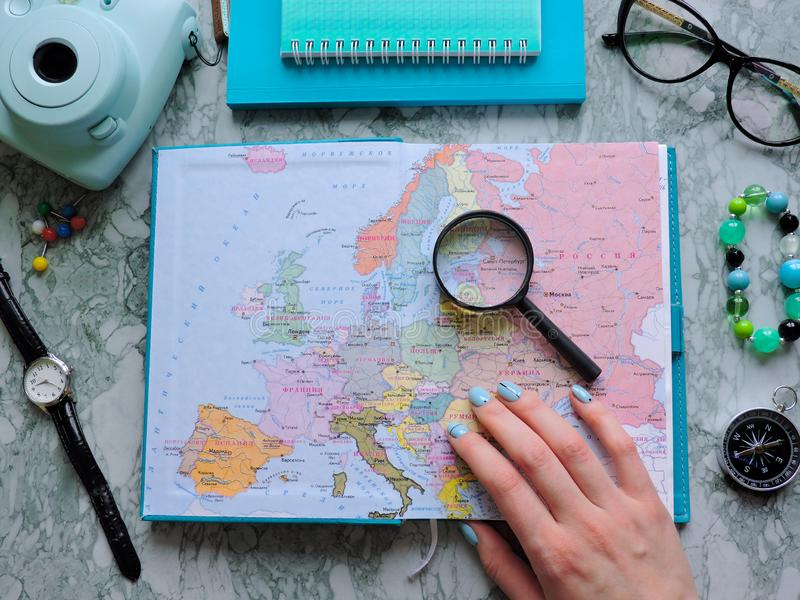 Top View of a map and items. Planning a trip or adventure. Travel planning dreams. Map of the world. Travel, tourism and vacation concept background. Stylish stock photography