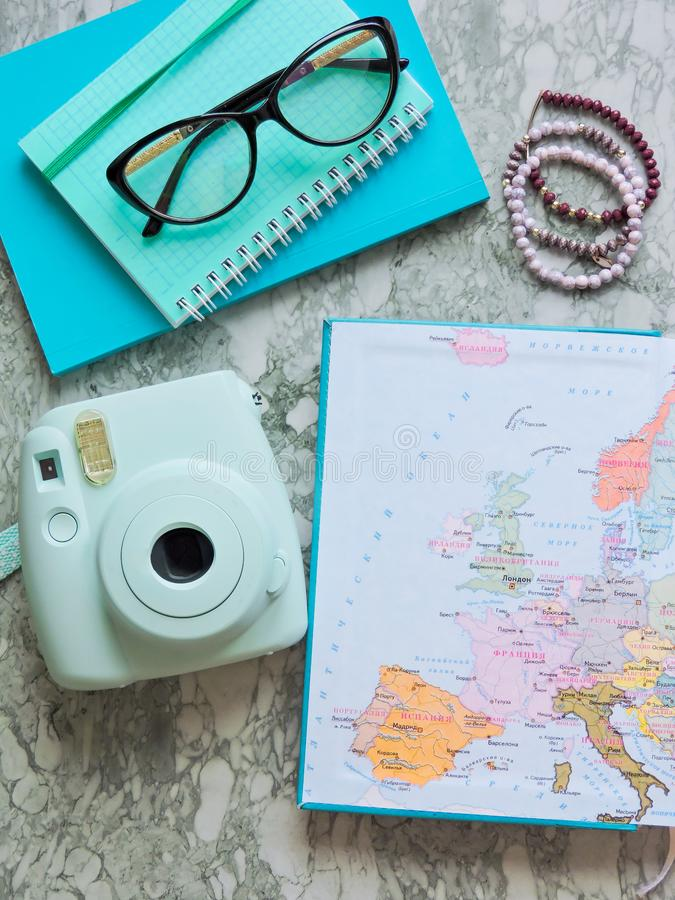 Top View of a map and items. Planning a trip or adventure. Travel planning dreams. Map of the world. Travel, tourism and vacation concept background. Stylish stock photo