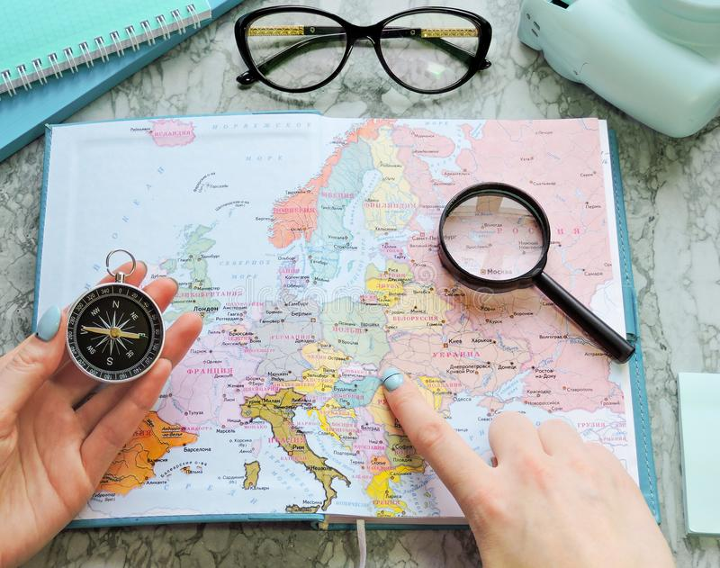 Top View of a map and items. Planning a trip or adventure. Travel planning dreams. Map of the world. Travel, tourism and vacation concept background. Stylish stock images