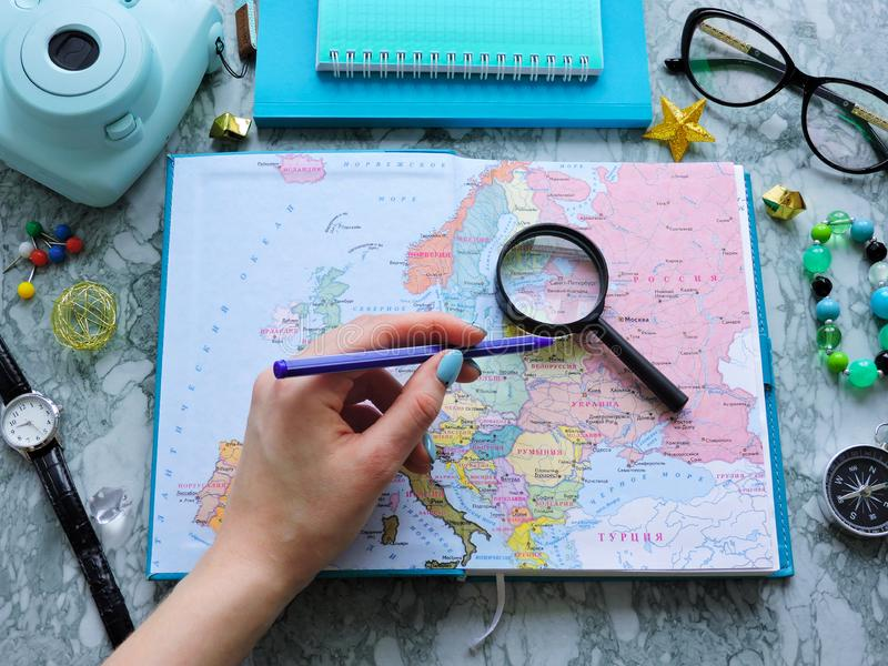 Top View of a map and items. Planning a trip or adventure. Travel planning dreams. Map of the world. Travel, tourism and vacation concept background. Stylish royalty free stock image