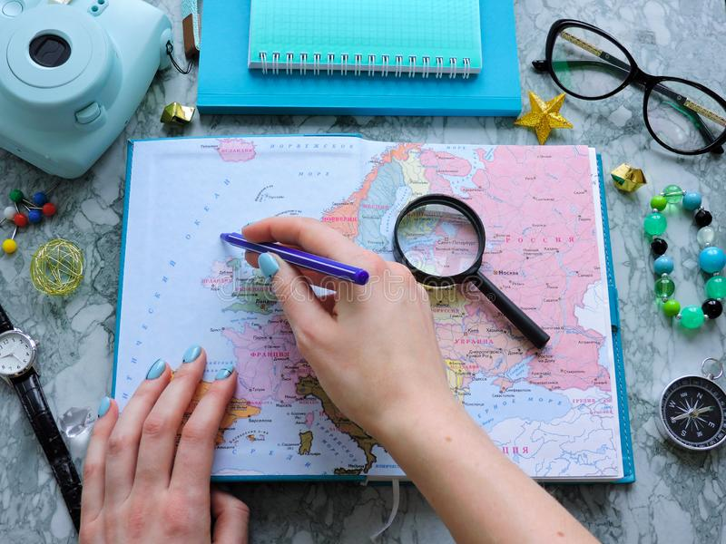 Top View of a map and items. Planning a trip or adventure. Travel planning dreams. Map of the world. Travel, tourism and vacation concept background. Stylish royalty free stock photography